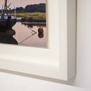 Floated with a white lacquer frame