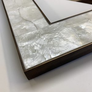 Mother of pearl with bronze frame