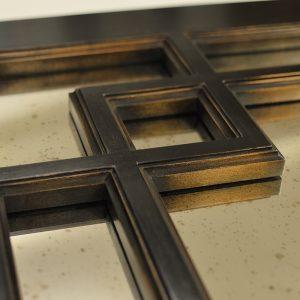 Aged bronze frame corner detail